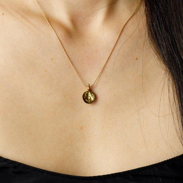 shakti circular gold pendant