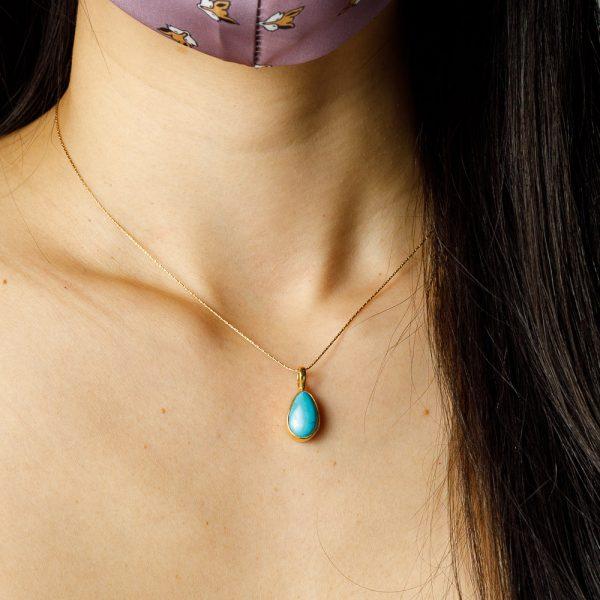 shakti turquoise pendant on gold necklace
